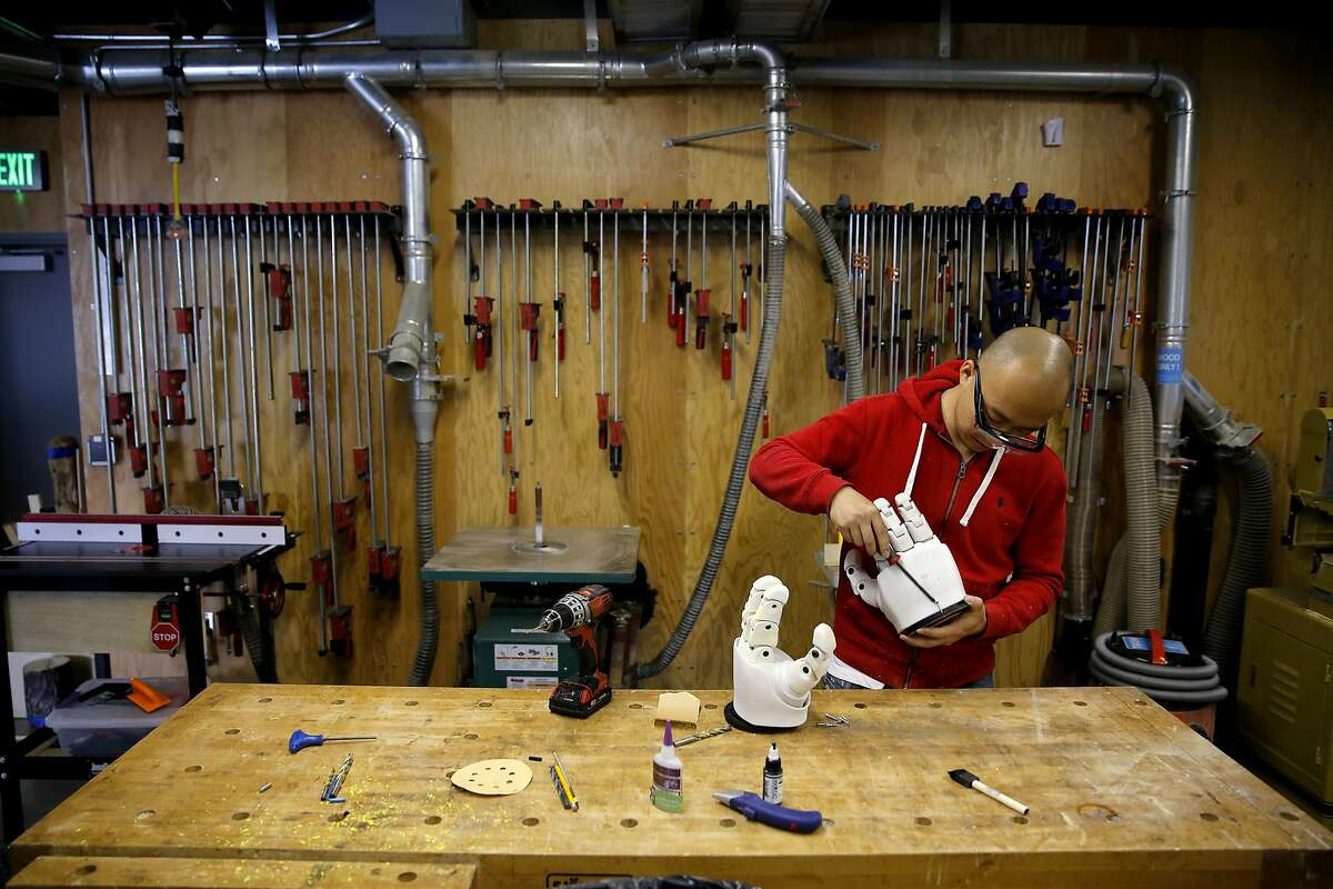 Yue Shi works on the hands of a robot he is building at Autodesk's offices at Pier 9 in San Francisco, California, on Wednesday, Sept. 30, 2015.