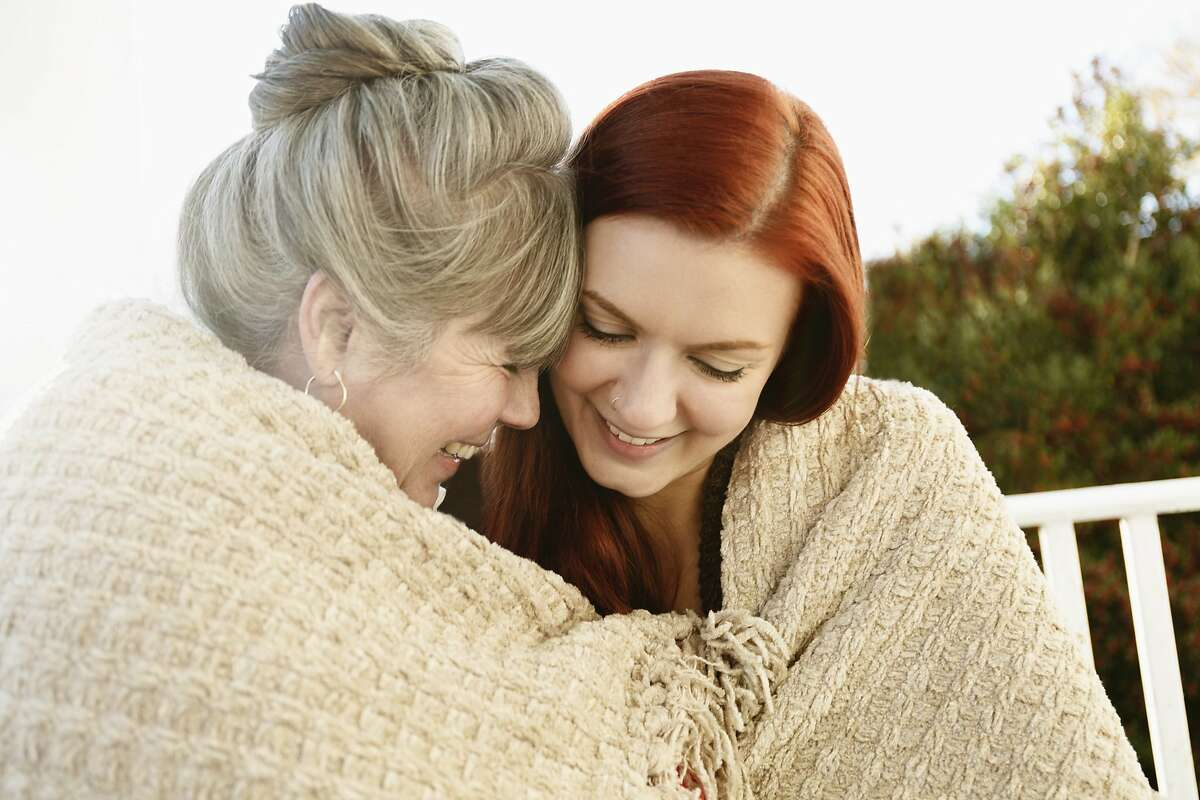 A young woman sees nothing wrong with having a close relationship with her mom.
