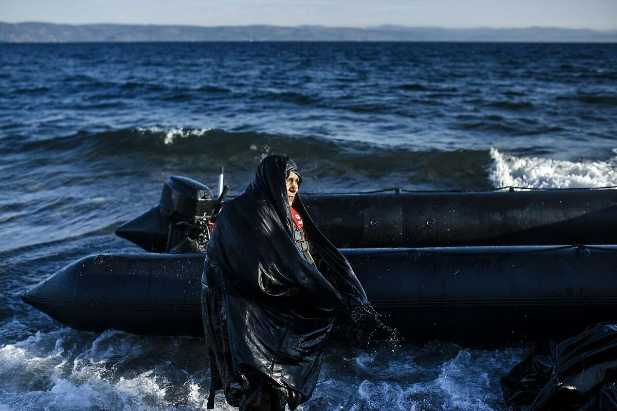 TOPSHOTS An elderly woman is pictured after arriving on the Greek island of Lesbos, after crossing the Aegean sea from Turkey, on October 15, 2015. More than 400,000 refugees, mostly Syrians and Afghans, arrived in Greece since early January while dozens were drowned trying to make the crossing. In total 710,000 have entered the EU through Greece and Italy during the same period, according to the European Agency Frontex border surveillance. The migration issue has caused deep divisions within the European Union, which is trying to set the distribution of migrants among its member countries or limit the flow. AFP PHOTO / DIMITAR DILKOFFDIMITAR DILKOFF/AFP/Getty Images