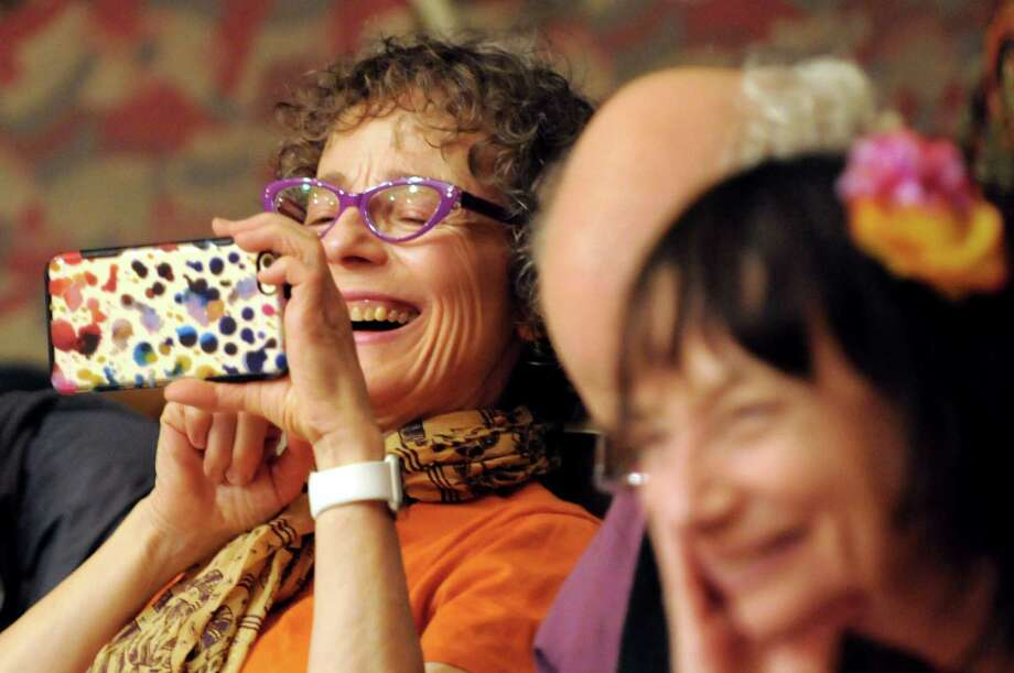 Mary DiMichele of Montreal, left, enjoys the birds calls as she records Ruth Yarrow's presentsentation Haiku with Feathers at the Haiku North America autumn conference on Friday, Oct. 16, 2015, at Union College in Schenectady, N.Y. (Cindy Schultz / Times Union) Photo: Cindy Schultz / 10033792A