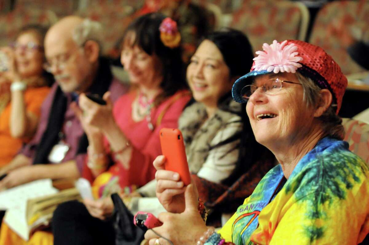 Janis Lukstein of Palos Verdes Peninsula, Calif., right, enjoys the birds calls as Ruth Yarrow presents Haiku with Feathers at the Haiku North America autumn conference on Friday, Oct. 16, 2015, at Union College in Schenectady, N.Y. (Cindy Schultz / Times Union)