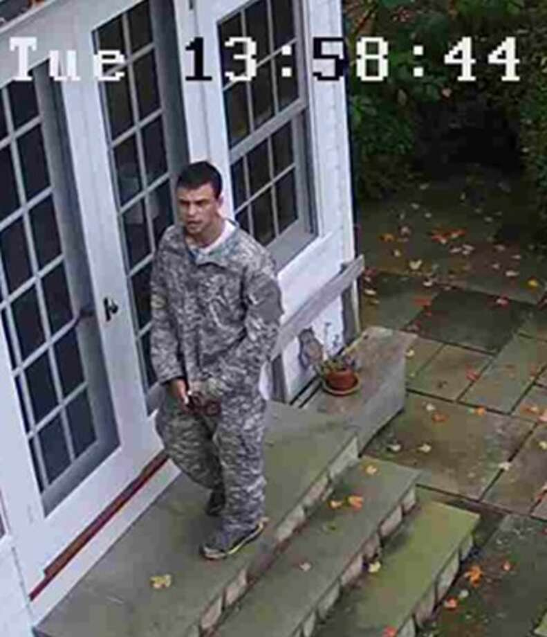 Photos from a surveillance camera show a suspect during a burglary in Roxbury on Tuesday. Photo: Contributed / Connecticut State Police