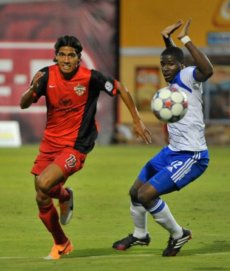 Scorpions Josue Soto battles Edmonton's Kareem Moses for the ball during the first half of their NASL match at Toyota Field on Sept. 6. Photo: Robin Jerstad /For The Express-News