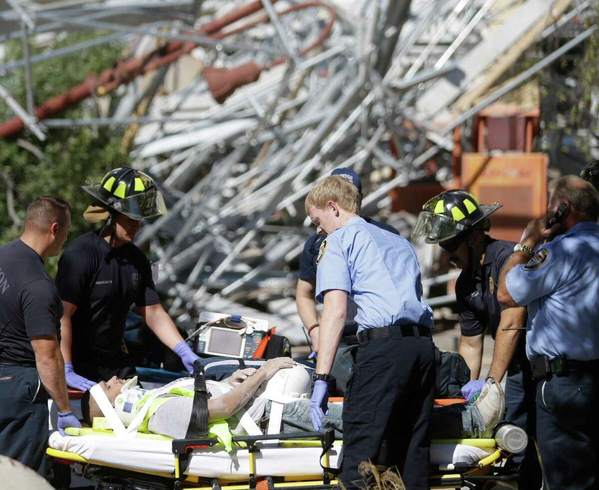 Scene at scaffolding collapse at a building under construction on Crawford near Congress across the street from Minute Maid Park shown Friday, Oct. 16, 2015, in Houston.