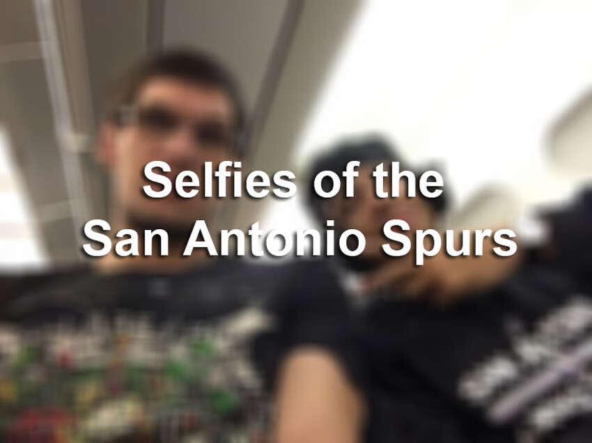 The Spurs posed for selfies with a their new piece of championship jewelry.