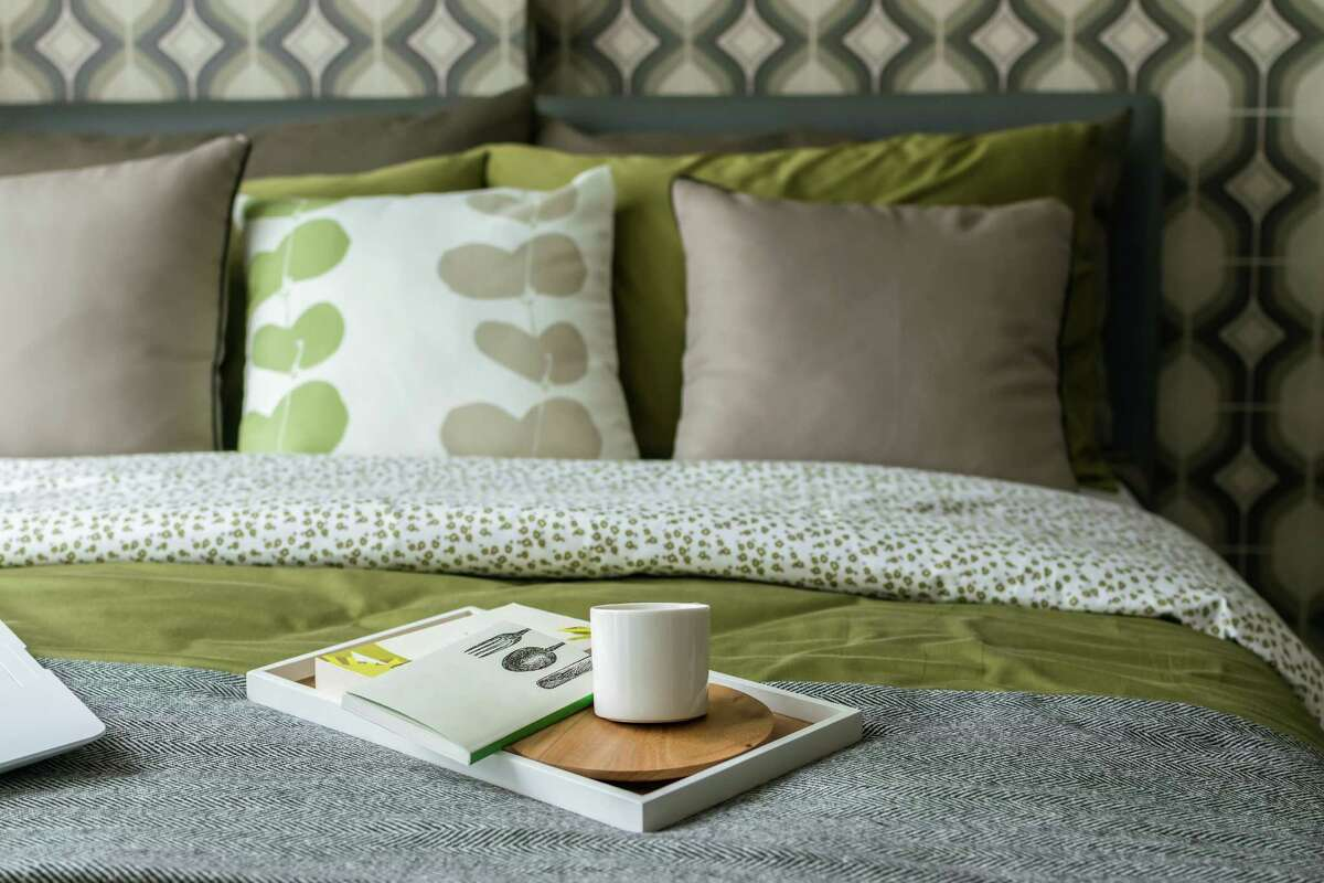Retro bedroom with hints of gray and green accents. (Fotolia)