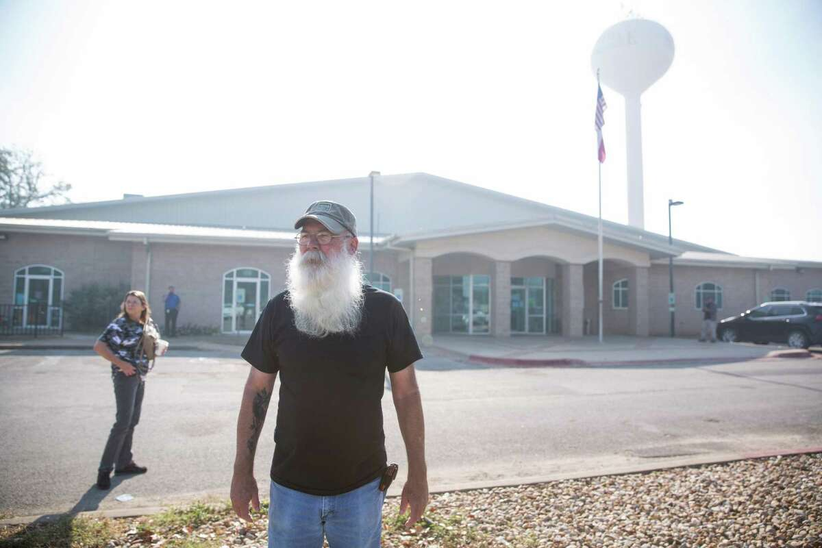 Robert Glasgow stands outside of the Red Cross Shelter for evacuees of the fire set up in the Smithville Recreation Center in Smithville, Texas on October 16, 2015. He said his house and the 4.59 acres it sat on, which are for sale, are