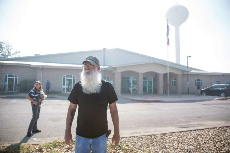 "Robert Glasgow stands outside of the Red Cross Shelter for evacuees of the fire set up in the Smithville Recreation Center in Smithville, Texas on October 16, 2015.  He said his house and the 4.59 acres it sat on, which are for sale, are ""freshly toasted.""  ""I'm tough,"" he said.  ""I worry about the ones with kids.  They are the ones my heart goes out to."" Photo: Carolyn Van Houten / 2015 San Antonio Express-News"