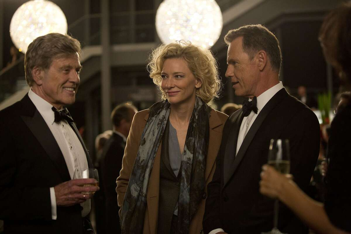 """In this image released by Sony Pictures Classics, Robert Redford portrays Dan Rather, from left, Cate Blanchett portrays Mary Mapes and Bruce Greenwood portrays Andrew Heyward in a scene from, """"Truth."""" (Lisa Tomasetti /Sony Pictures Classics via AP)"""