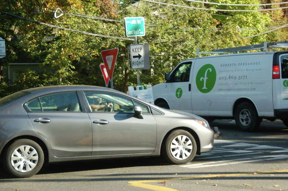 The Old Greenwich traffic circle near Perrot Library could soon be getting the improvements residents have been asking for. Photo: / Ken Borsuk