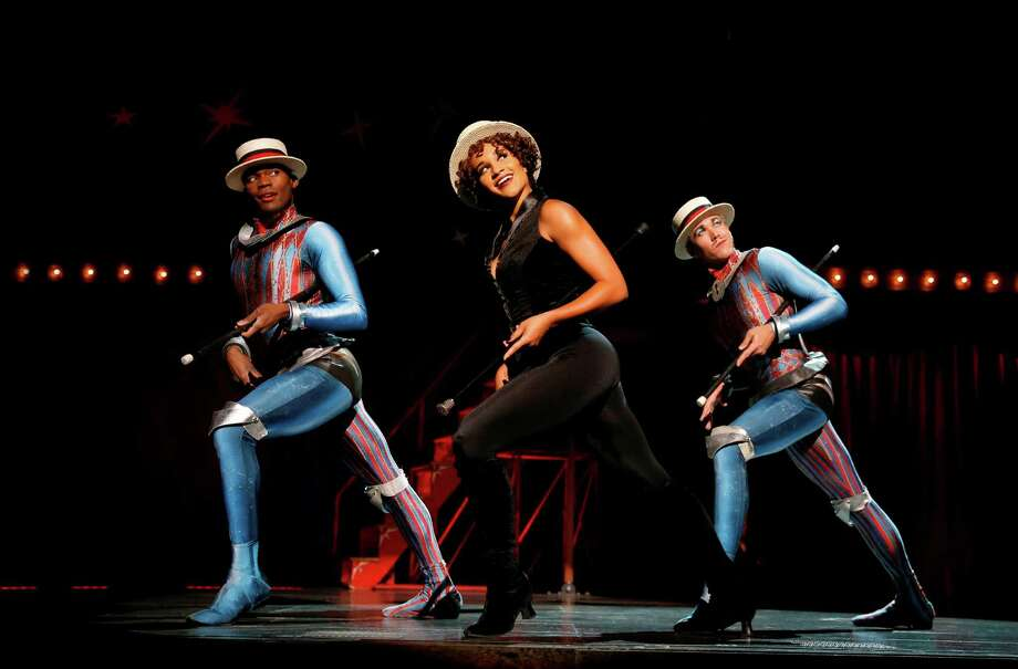 "Gabrielle McClinton as Leading Player (center) is flanked by Borris York (left) and Matthew deGuzman in the famous dance trio that exemplifies the Bob Fosse style still crucial to ""Pippin.""
