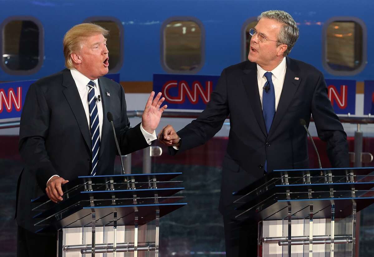 Republican presidential candidates Donald Trump (L) and Jeb Bush argue during the presidential debates at the Reagan Library on September 16, 2015 in Simi Valley, California. Fifteen Republican presidential candidates are participating in the second set of Republican presidential debates.