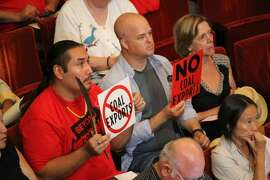 Critics protest the export of coal at the public hearing at Oakland City Hall on September 21. Photo by Lucas Waldron.
