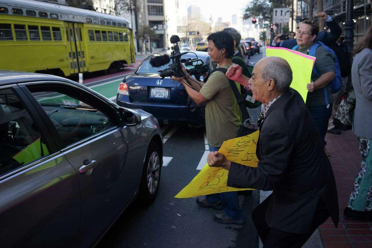 Jorge Cordero Valdez protests in front of Uber headquarters on Market Street in San Francisco Friday.
