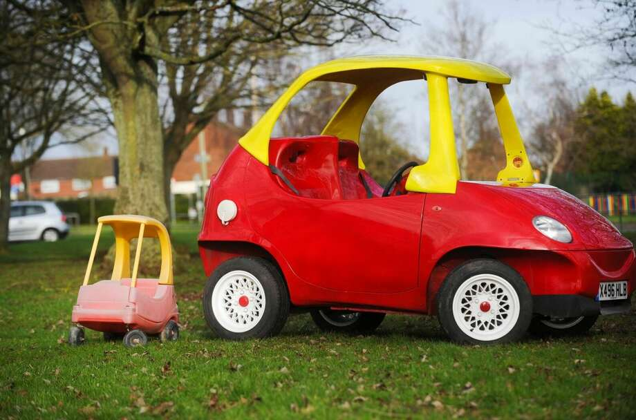 The winner of a United Kingdom-based eBay auction will be able to feel like a kid with a driver's license behind the wheel of an oversized version of the classic Little Tikes Coupe. Photo: Mendoza, Madalyn S, Provided By John Bitmead