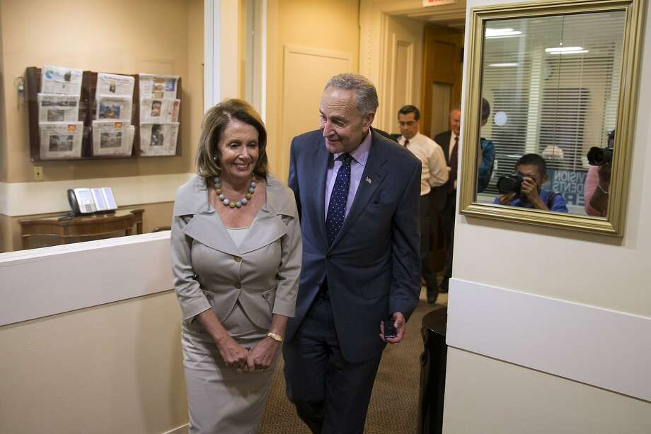 House Minority Leader Nancy Pelosi, who has held her fractious ranks together, talks with Sen. Chuck Schumer. Photo: Evan Vucci, Associated Press