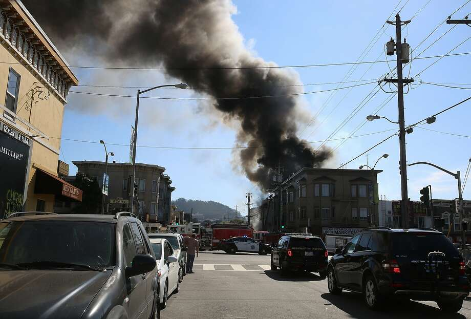 A three-alarm fire at 425 2nd Ave. in San Francisco, Calif., significantly damaged a home on Friday, October 16, 2015.  No injuries were reported. Photo: Liz Hafalia, The Chronicle