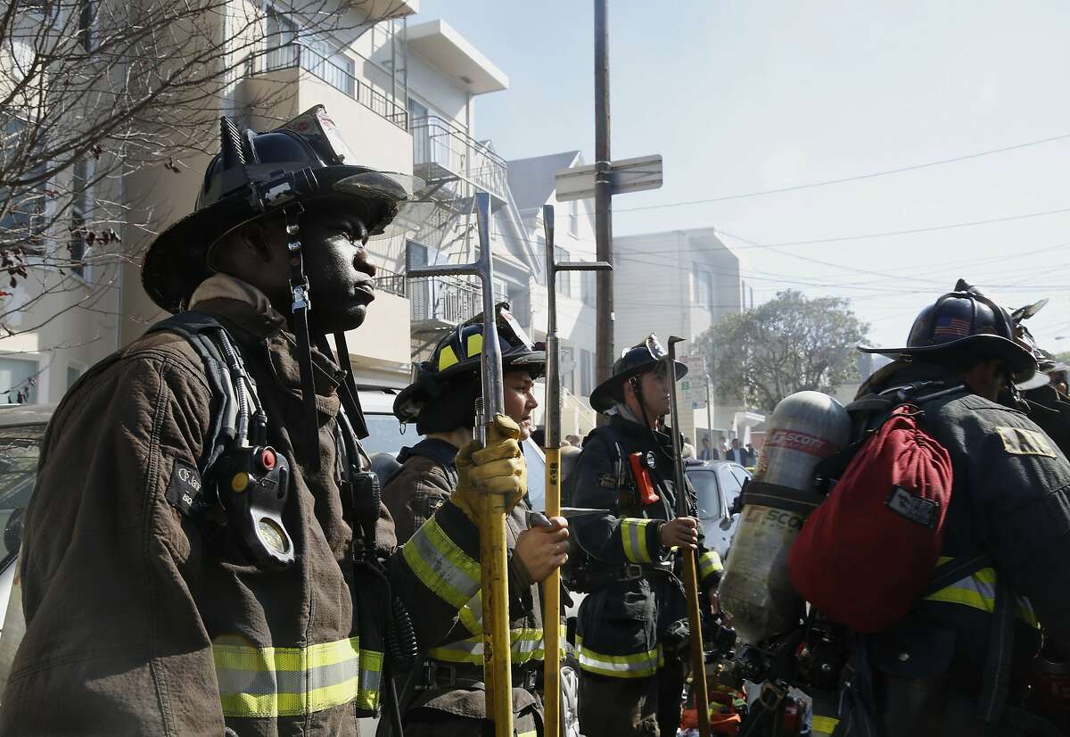 Firefighters work to extinguish a three-alarm fire at 425 2nd Ave. in San Francisco, Calif., significantly damaged a home on Friday, October 16, 2015. No injuries were reported.
