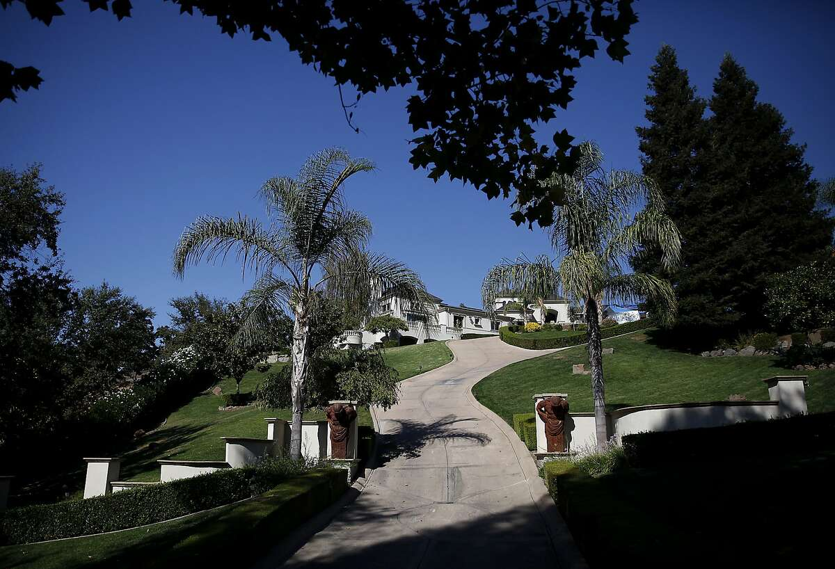 This home is one of several on a list for water-wasters in the Saddleback at Blackhawk gated community in Danville, Calif., on Friday, October 16, 2015.