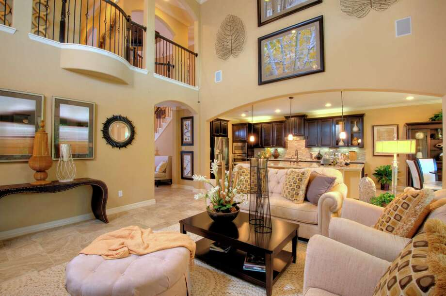 Harmony presents new model homes houston chronicle for Fully decorated homes