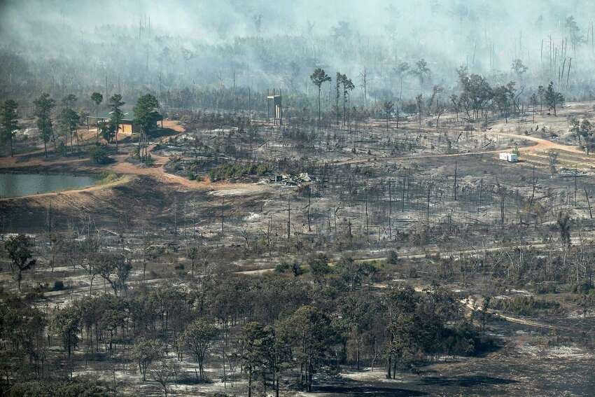 In this aerial photo, smoke billows from the Hidden Pines Fire near Smithville, Texas, Friday, Oct. 16, 2015. A preliminary investigation indicates a farming accident sparked the wildfire that's consumed more than 7 square miles and destroyed 40 structures in Central Texas, authorities said Friday. (Rodolfo Gonzalez/Austin American-Statesman via AP) AUSTIN CHRONICLE OUT, COMMUNITY IMPACT OUT, INTERNET AND TV MUST CREDIT PHOTOGRAPHER AND STATESMAN.COM, MAGS OUT; MANDATORY CREDIT