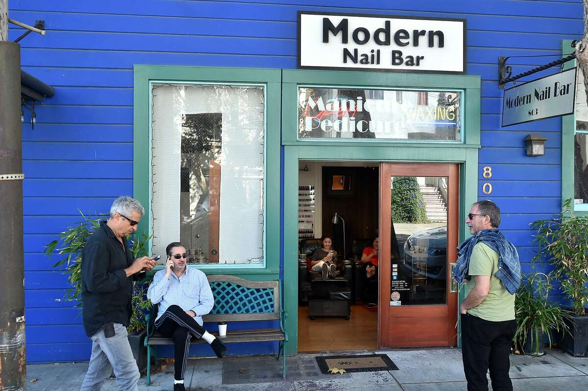 Men congregate near a nail salon in the dogpatch neighborhood of San Francisco on October 16, 2015.