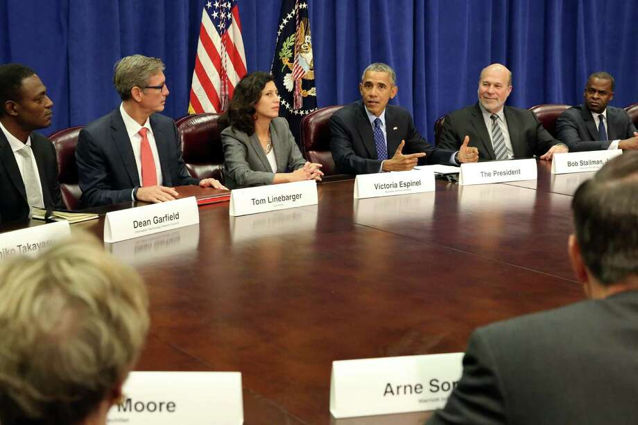 WASHINGTON, D.C. - OCTOBER 6:  President Barack Obama meets with agriculture and business leaders at the Department of Agriculture October 6, 2015 in Washington, D.C. The President discussed the benefits of the Trans-Pacific Partnership for American businesses and workers. Flanking the president are Victoria Espinel, CEO, The Software Alliance and Bob Stallman, Jr., President, American Farm Bureau. (Photo by Martin H. Simon-Pool/Getty Images) Photo: Pool / 2015 Getty Images