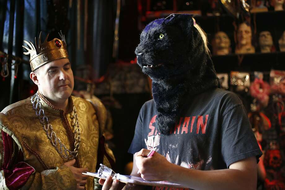 Costumes on Haight manager Chuck Nicklow (left) with sales clerk Joe Sams in a black panther mask. Photo: Liz Hafalia, The Chronicle