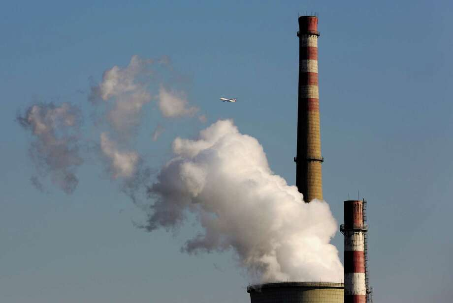 Paying the difference between the cheapest resource and a clean one could deliver a push to peak pollution levels and begin to reduce emissions, according to an IEA analyst. Photo: Associated Press File Photo / AP