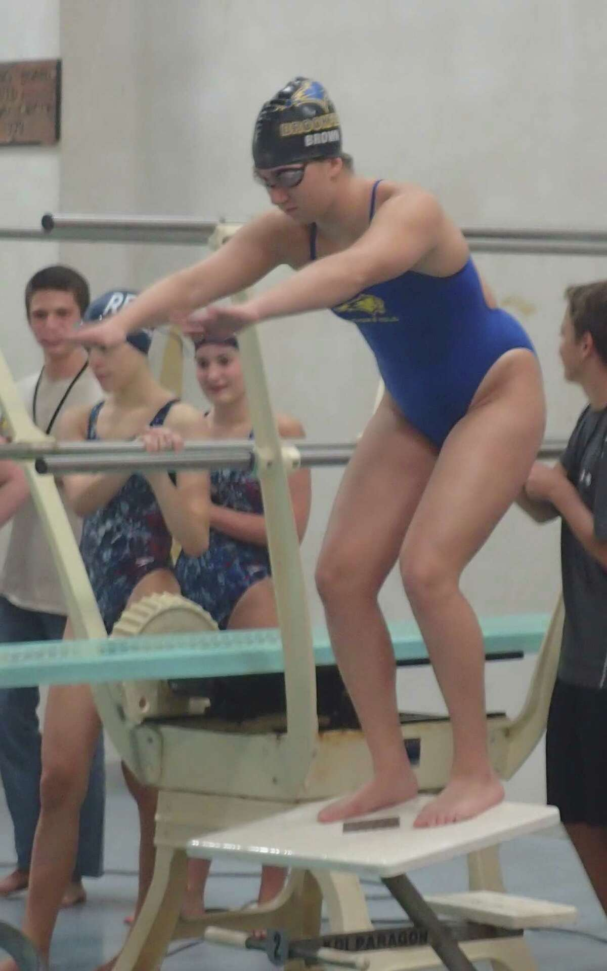 Brookfield's Rachel Brown gets set to swim the anchor leg of the 200-yard medley relay during Friday's meet at New Fairfield High School, Oct. 16, 2015.