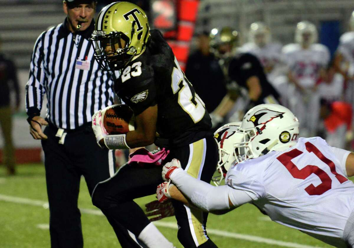 Trumbull's Markeese Woods tries to break free of the grip of Greenwich's Ben Kraninger during high school football action in Trumbull, Conn. on Friday October 16, 2015.