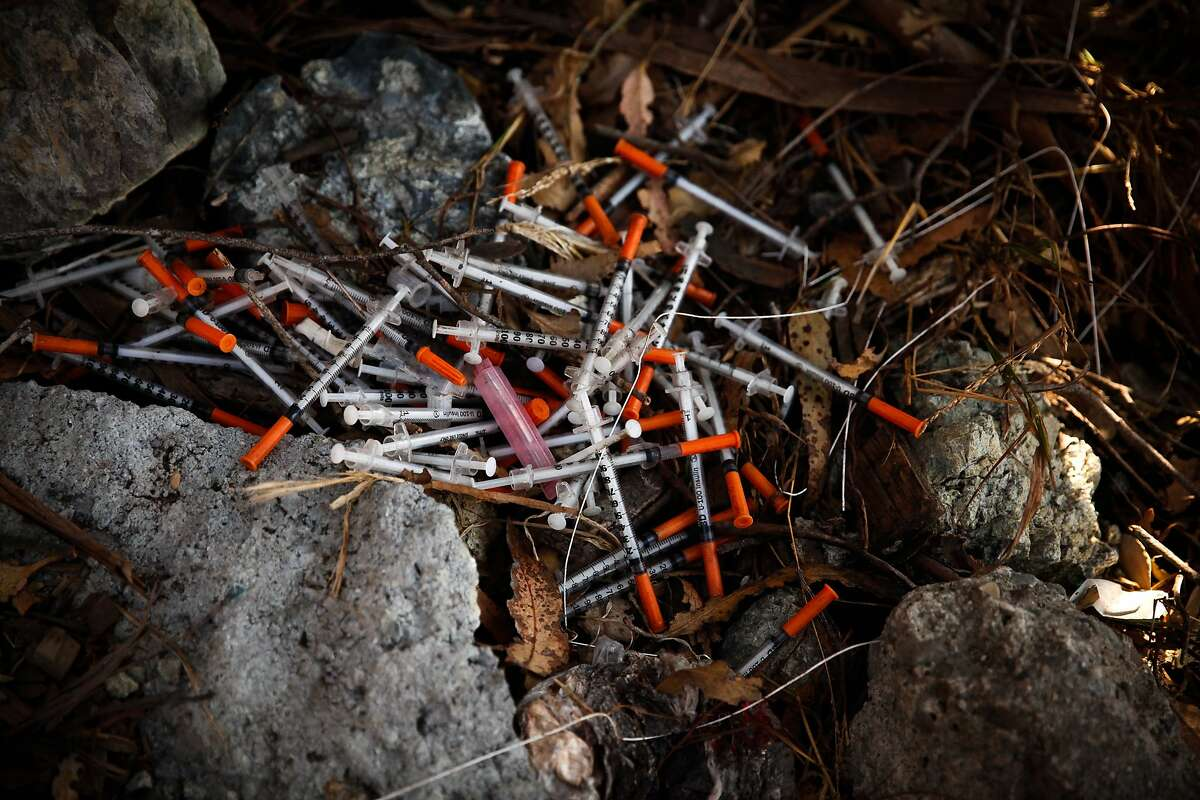 Needles left behind on the hill where many homeless camp in Potrero Hill, San Francisco.