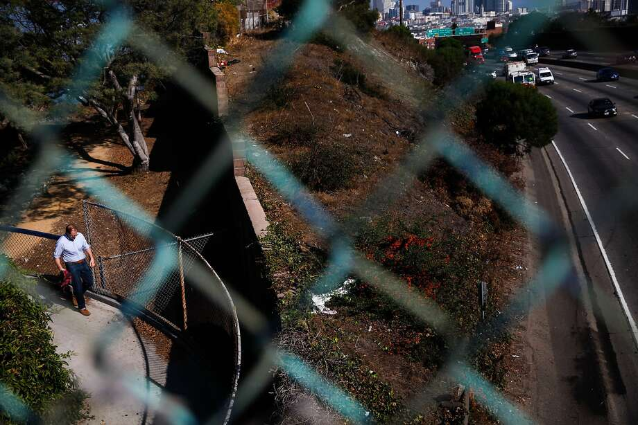 JR Eppler, a resident of Potrero Hill, walks on the ramp that borders an area where many homeless used to camp along Highway 101 until Caltrans cut the trees and bushes down in San Francisco. Photo: Sarah Rice, Special To The Chronicle