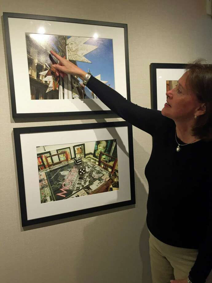 Photographer Barbara O'Shea points to her work on display at the Les Beaux Arts Gallery at the Round Hill Community Church. Photo: Sylvia Foster-Frau / Hearst Connecticut Media / Greenwich Time