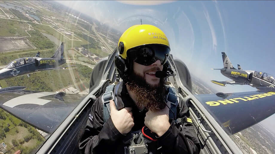Astros pitcher Dallas Keuchel finds an exhilarating way to put the ALDS heartbreak in his rearview mirror by catching a ride Friday with the Breitling Jet Team at Ellington Field. Photo: Jon Shapley, Staff / © 2015 Houston Chronicle
