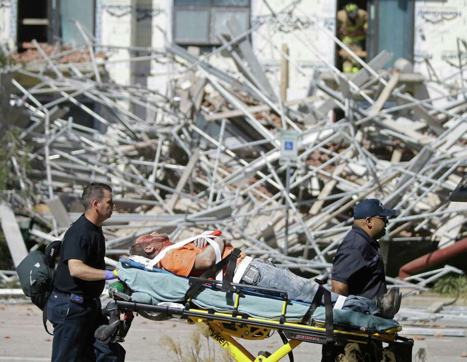 This man was one of six people injured when scaffolding fell at a  building under construction on Crawford near Congress. Photo: Melissa Phillip, Staff / © 2015 Houston Chronicle