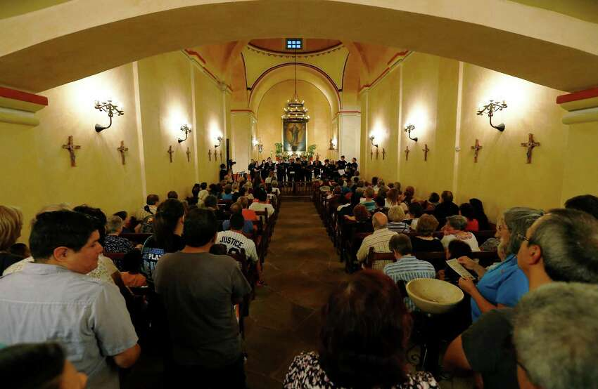 Members of the San Antonio Choral Society perform in the chapel of Mission Concepcion as part of the World Heritage Site Celebrations on Friday, Oct. 16, 2015. The San Antonio Office of Historic Preservation hosted the event featured a light projection on the mission of how it originally looked according to officials. Guests were also treated to tours around the mission, music and food.