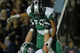 Reagan's Alex Santiago celebrates his TD with teammate Derek Kerstetter after his 2nd quarter 51 yard TD in the District 26-6A high school football game between Reagan and Churchill at Comalander Stadium on Friday, October 16,2015.