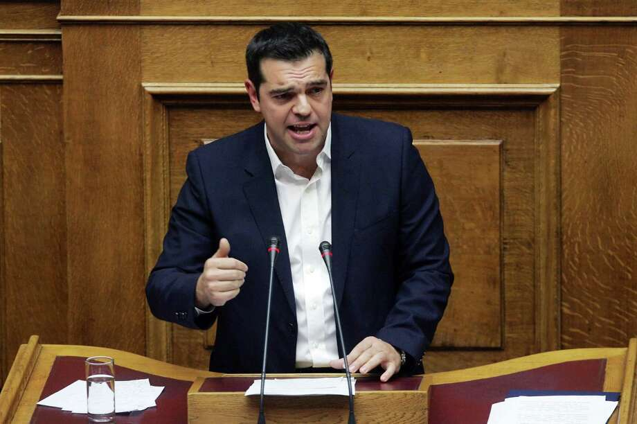 Greek Prime Minister Alexis Tsipras addresses lawmakers at the Greek parliament in Athens on October 16, 2015, as Greece's parliament is expected to approve later a first batch of reforms and tax cuts stemming from its third EU bailout. The vote, scheduled for around midnight, is expected to be won by the leftist government of Prime Minister Alexis Tsipras, which has 155 lawmakers in the 300-seat chamber. AFP PHOTO / LOUISA GOULIAMAKILOUISA GOULIAMAKI/AFP/Getty Images Photo: LOUISA GOULIAMAKI, Stringer / AFP