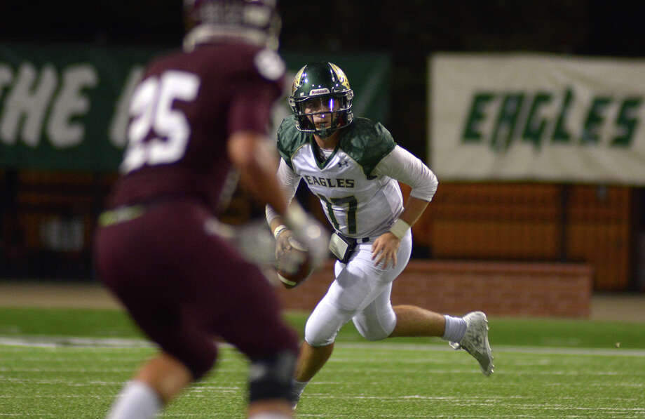Cy-Falls senior quarterback Casey Rodellini (17) looks for a receiver downfield against senior defensive back Spencer Wright (25) and the Bobcat defense during their district matchup at the Berry Center in Cypress on Friday, Oct. 16, 2015. (Photo by Jerry Baker/Freelance)4 Photo: Jerry Baker, For The Houston Chronicle