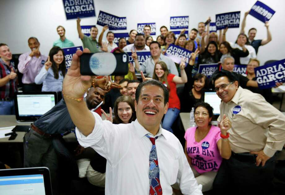"Mayoral candidate Adrian Garcia takes a ""selfie"" with his supporters during a visit to the campaign's call center, Wednesday, Oct. 14, 2015, in Houston. Photo: Mark Mulligan / © 2015 Houston Chronicle"