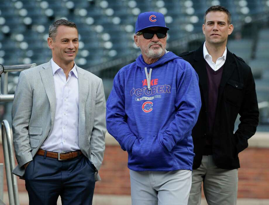 Manager Joe Maddon, left, and Theo Epstein, president of baseball operations, have teamed up this season to get the Cubs to within four games of their first World Series in 70 years. Photo: Julie Jacobson, STF / AP