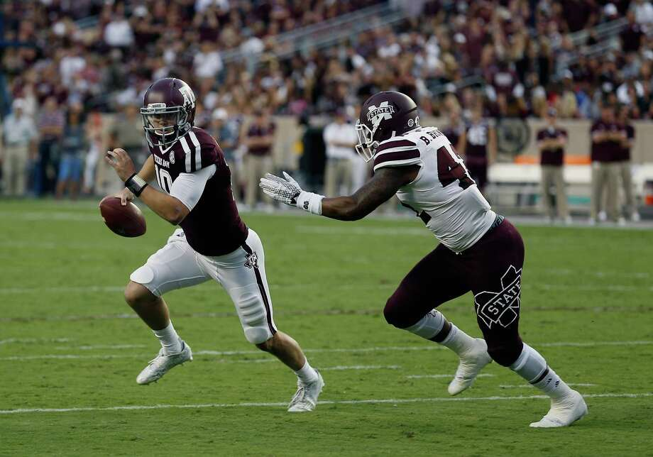 Playing against SEC competition like Mississippi State's Benique Brown keeps Texas A&M quarterback Kyle Allen, left, on his toes. But then again, that's a big reason Allen was attracted to A&M in the first place. Photo: Bob Levey, FRE / FR156786 AP