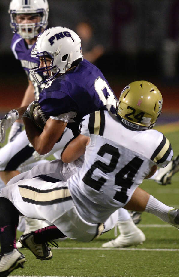 Nederland's Peyton Devries takes down Port Neches-Groves' Caisen Sullivan during the Mid-County Madness matchup at the Reservation Friday night. Photo taken Friday, October 16, 2015 Guiseppe Barranco/The Enterprise Photo: Guiseppe Barranco, Photo Editor