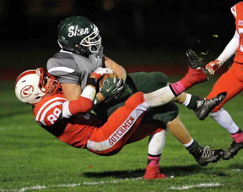 Shenendehowa's Nicholas Cosgrove is tackled at the end zone by Guilderland's Sean Murphy, #88, but gets the touchdown during a football game on Friday, Oct. 16, 2015 in Guilderland, N.Y. (Lori Van Buren / Times Union)