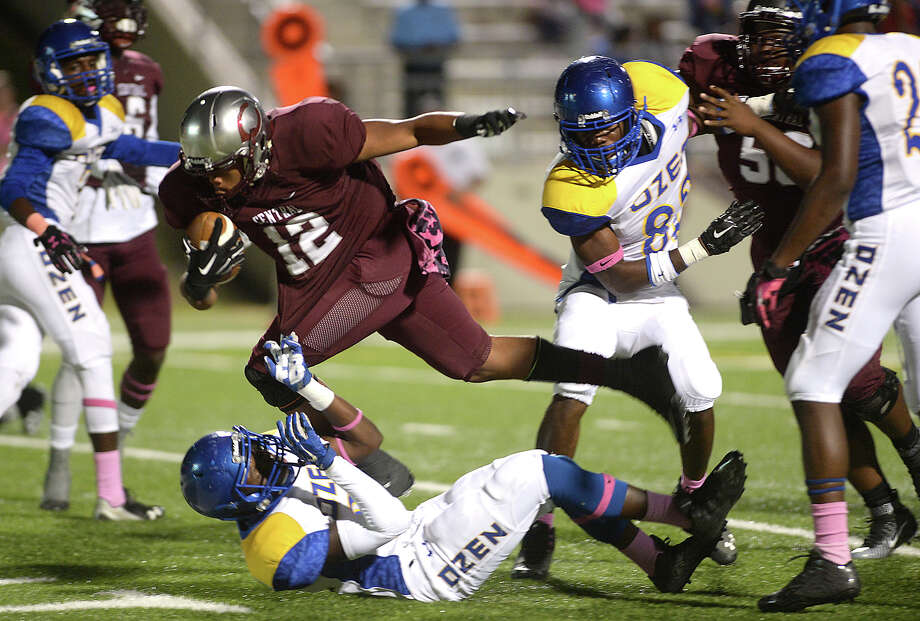 Central's Devwah Whaley powers through Ozen's defense as he carries the ball into the enzone for the first Jaguar touchdown during the annual Soul Bowl Friday night at the Thomas Center. The rivalry extends well beyond the playing field, with bands and fans looking to outdo one another in what is a highlight of Beaumont high schools' legendary rivalry.  Photo taken Friday, October 16, 2015  Kim Brent/The Enterprise Photo: Kim Brent / Beaumont Enterprise