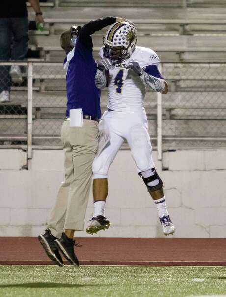 Montgomery coach John Bolfing and wide receiver Jake Loera were walking on air after Loera's long touchdown catch in Friday's District 15-6A game against Spring at George Stadium. Photo: Joe Buvid, Freelance / © 2015 Joe Buvid