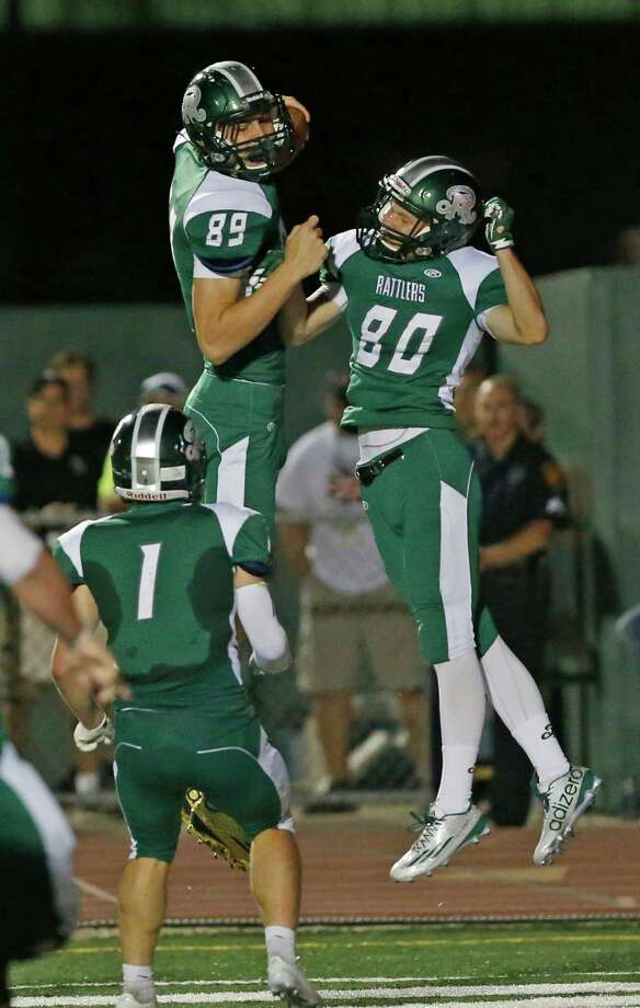 Reagan's River Reed celebrates his TD reception with Jared Sthele (right) in a District 26-6A game at Comalander Stadium on Oct. 16, 2015. Photo: Ron Cortes /For The Express-News