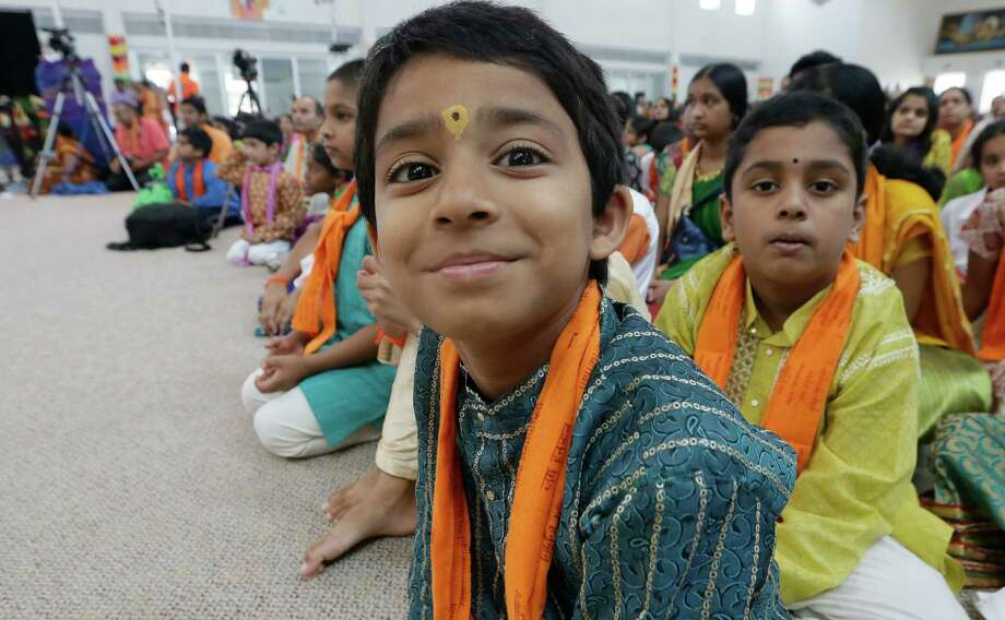 "Texas is on track to becoming more ""international,"" says the state demographer. In this August photo, children of Asian Indian decent sit at the Karya Siddhi Hanuman Temple in Frisco, Texas. Photo: LM Otero /Associated Press / AP"