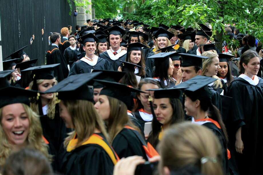 Women and men choose majors for different reasons but whatever the reasons this results in wage gaps between the genders, with men earning more. This is the 2012 Princeton University graduating class. Photo: Mel Evans /Associated Press / AP